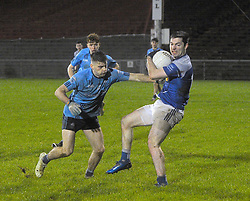 Claremorris's Colin standing firm as Westport's Oisin McLaughlin gets a tackle in during the Mayo U21 Final.<br />