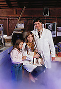 Experimental cryonics: Paul Segall in his garage laboratory in Berkeley, California, with his family and Miles, a beagle. Segall replaced Miles' blood with a substitute before cooling him to 37.4 degrees & disconnecting a heart lung machine. After 15 minutes, during which Miles' pulse, breathing & circulation had ceased, the dog was warmed, its blood returned & Miles was restored to health.  Human cryonics clients are frozen & preserved in liquid nitrogen to await the advances in medical science that a future thaw might bring about. However, conventional cryobiology methods for freezing organs are plagued by problems of intracellular ice formation, which destroys cells. Cryonics is a speculative life support technology that seeks to preserve human life in a state that will be viable and treatable by future medicine. MODEL RELEASED 1987..