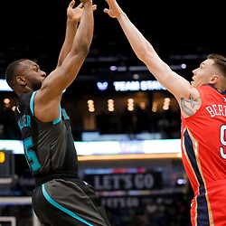 Apr 3, 2019; New Orleans, LA, USA;  Charlotte Hornets guard Kemba Walker (15) shoots over New Orleans Pelicans guard Dairis Bertans (9) during the first quarter at the Smoothie King Center. Mandatory Credit: Derick E. Hingle-USA TODAY Sports