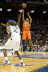 Virginia guard Sean Singletary (44) shoots a jump shot against Georgia Tech.  The Virginia Cavaliers fell to the Georgia Tech Yellow Jackets 94-76  in the first round of the 2008 ACC Men's Basketball Tournament at the Charlotte Bobcats Arena in Charlotte, NC on March 13, 2008.