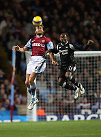 Photo: Rich Eaton.<br /> <br /> Aston Villa v Manchester City. The Barclays Premiership. 29/11/2006. Olof Mellberg left of Villa outjumps City goalscorer Darius Vassell