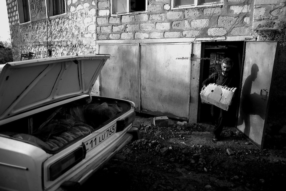 "In the early morning baker Armen load his car and delivers bread to local shops in Shushi. This image is part of the photoproject ""The Twentieth Spring"", a portrait of caucasian town Shushi 20 years after its so called ""Liberation"" by armenian fighters. In its more than two centuries old history Shushi was ruled by different powers like armeniens, persians, russian or aseris. In 1991 a fierce battle for Karabakhs independence from Azerbaijan began. During the breakdown of Sowjet Union armenians didn´t want to stay within the Republic of Azerbaijan anymore. 1992 armenians manage to takeover ""ancient armenian Shushi"" and pushed out remained aseris forces which had operate a rocket base there. Since then Shushi became an ""armenian town"" again. Today, 20 yeras after statement of Karabakhs independence Shushi tries to find it´s opportunities for it´s future. The less populated town is still affected by devastation and ruins by it´s violent history. Life is mostly a daily struggle for the inhabitants to get expenses covered, caused by a lack of jobs and almost no perspective for a sustainable economic development. Shushi depends on donations by diaspora armenians. On the other hand those donations have made it possible to rebuild a cultural centre, recover new asphalt roads and other infrastructure. 20 years after Shushis fall into armenian hands Babies get born and people won´t never be under aseris rule again. The bloody early 1990´s civil war has moved into the trenches of the frontline 20 kilometer away from Shushi where it stuck since 1994. The karabakh conflict is still not solved and could turn to an open war every day. Nonetheless life goes on on the south caucasian rocky tip above mountainious region of Karabakh where Shushi enthrones ever since centuries."
