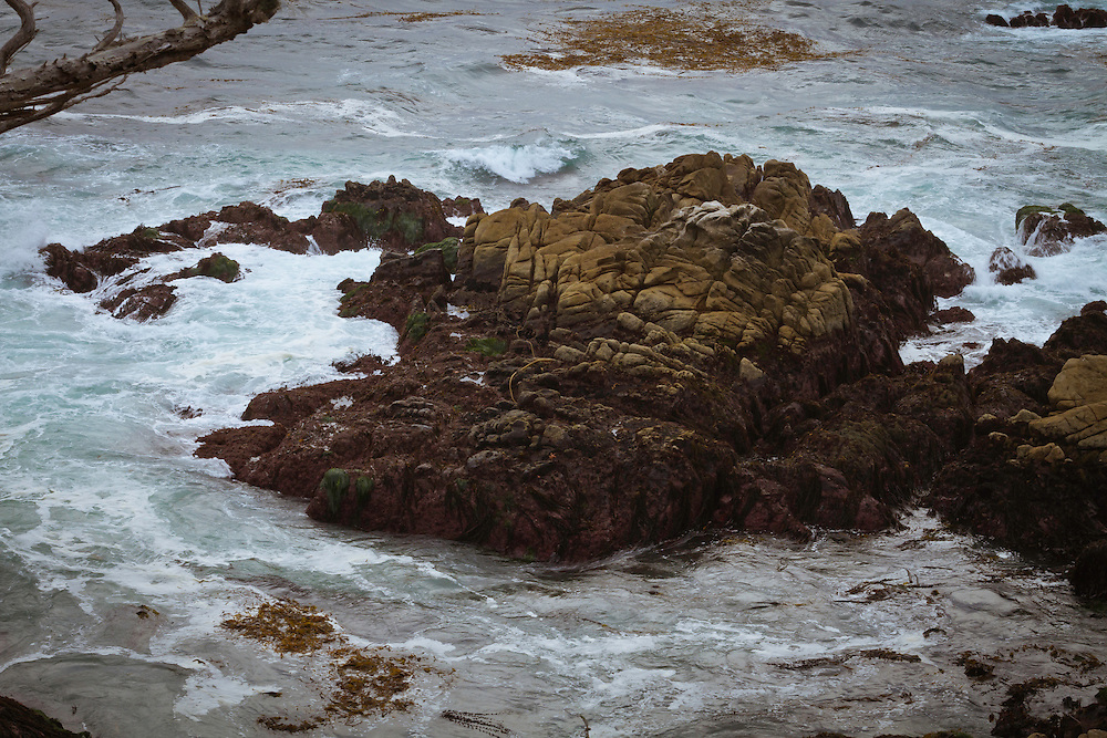 Heavy Red Rock in the Stormy Sea