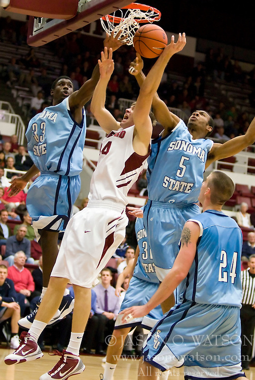 November 6, 2009; Stanford, CA, USA;  Stanford Cardinal forward Andrew Zimmermann (34) is fouled while shooting by Sonoma State Seawolves forward/center Dominic Powell (5) during the first half of an exhibition game at Maples Pavilion.