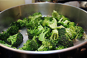 Broccoli recovered from dumping sites around the island of Manhattan, New York, NY., being cooked during a Freegan dinner, on Friday, July 7, 2006. Freegans are a community of people who aims at recovering wasted food, books, clothing, office supplies and other items from the refuse of retail stores, frequently discarded in brand new condition. They recover goods not for profit, but to serve their own immediate needs and to share freely with others. According to a study by a USDA-commissioned study by Dr. Timothy Jones at the University of Arizona, half of all food in the United States is wasted at a cost of $100 billion dollars every year. Yet 4.4 million people in the United States alone are classified by the USDA as hungry. Global estimates place the annual rate of starvation deaths at well over 8 million. The massive waste generated in the process fills landfills and consumes land as new landfills are built. This waste stream also pollutes the environment, damages public health as landfills chemicals leak into the ground, and incinerators spew heavy metals back into the atmosphere. Freegans practice strategies for everyday living based on sharing resources, minimizing the detrimental impact of our consumption, and reducing and recovering waste and independence from the profit-driven economy. They are dismayed by the social and ecological costs of an economic model where only profit is valued, at the expense of the environment. In a society that worships competition and self-interest, Freegans advocate living ethical, free, and happy lives centred around community and the notion that a healthy society must function on interdependence. Freegans also believe that people have a right and responsibility to take back control of their time.