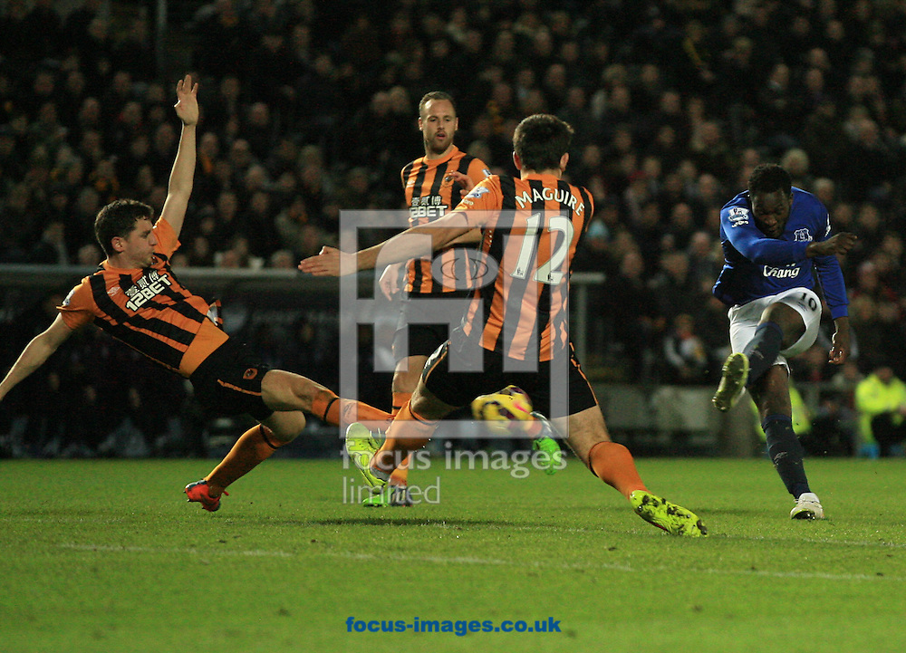 Alex Bruce (left) &amp; Harry Maguire of Hull City attempt to block the shot from Romelu Lukaku (right) of Everton during the Barclays Premier League match at KC Stadium, Hull<br /> Picture by Richard Gould/Focus Images Ltd +44 7855 403186<br /> 01/01/2015