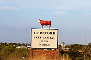 "Billing itself as the ""Beef Capital of the World"", this sign welcomes motorists traveling along US Highway 60 into the appropriately named town southwest of Amarillo."