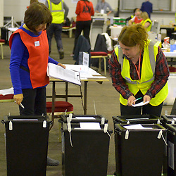 SCOTTISH PARLIAMENTARY ELECTION 2016 – Counting Agents checking the ballot boxes during the vote counting at Royal Highland Centre, Edinburgh<br />