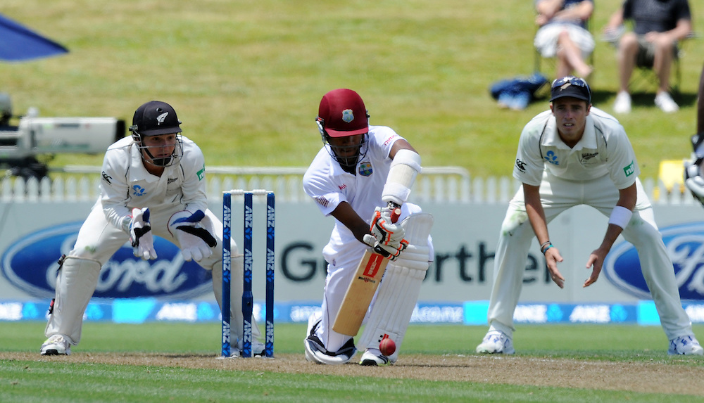 West Indies Kraigg Brathwaite plays forward in front of New Zealand's B J Watling  on the first day of the third International cricket match, Seddon Park, Hamilton, New Zealand, Thursday, December 19, 2013. Credit:SNPA / Ross Setford
