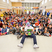 WWE Superstar Sin Cara reading to the elementary students at Bonham Elementary School, El Paso Texas , November 2, 2018