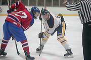 Victor's David Farrance, right, prepares for a face-off during a scrimmage against Fairport at Thomas Creek in Fairport on Monday, November 24, 2014.