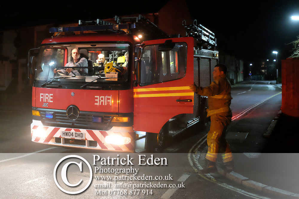 25 January 2016, News, Cowes, Isle of Wight, England, Large fire in former J Samuel White ship yard. Fire started in a garage unit, and rapidley spread to boat building and fabrication units. A fire has broken out at a workshop on an industrial estate on the Isle of Wight.<br /> <br /> Isle of Wight Fire and Rescue said more than 30 firefighters were tackling the blaze at Medina Village on Bridge Road in Cowes.<br /> <br /> Fifty fibreglass boats are believed to be on the premises as well as cars and acetylene cylinders. Large Fire, J Samuel Whites, Industrial Estate, Cowes, Isle of Wight,