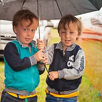 twin brothers Mathew and Thomas Kelly from Kildysart sheltering from the Rain during the 2014 Kildysart Agricultural Show