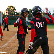 02 March 2018: San Diego State softball hosts Minnesota on day two of the San Diego Classic I at Aztec Softball Stadium. San Diego State outfielder Zaria Meshack (2) and outfielder Aris Metcalfe (00) celebrate after going up 5-2 in the bottom of the fourth. The Aztecs beat the #21/20 Gophers 6-2.<br /> More game action at sdsuaztecphotos.com