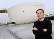 Teemu Kurkela, architect of Finnish Pavilion 'Kirnu', poses for a photograph in front of his creation, at Shanghai World Expo 2010, in Shanghai, China, on April 27, 2010. Photo by Lucas Schifres/Pictobank