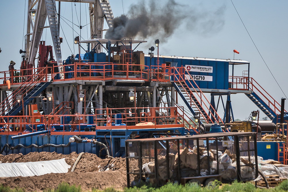Smoke drifts away frm Ffrackring rig in Snyder Texas in the Permian Basin, where fracking is done for oil.