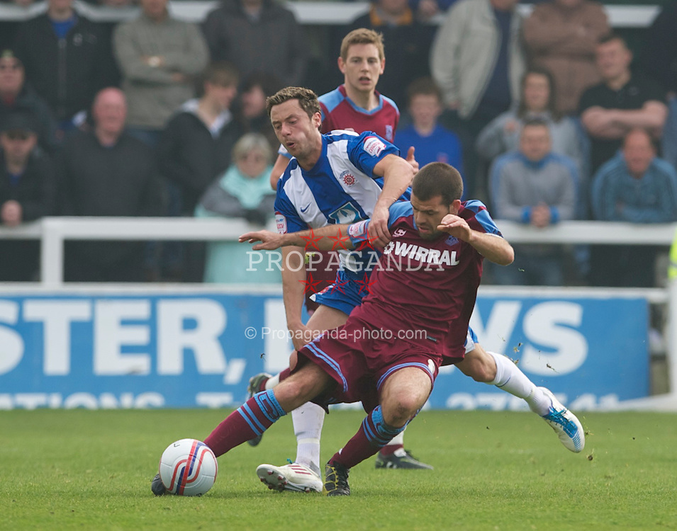 HARTLEPOOL, ENGLAND - Friday, April 22, 2011: Tranmere Rovers' John Welsh and Hartlepool United's Michael Mackay during the Football League One match at Victoria Park. (Photo by David Rawcliffe/Propaganda)