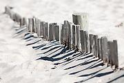 Buried beach fence