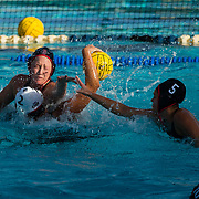 11 February 2018: The San Diego State  women's water polo team competes in day two of the Triton Invitation on the campus of UCSD. San Diego State Aztecs utility Courtney Jarvis (2) and driver Maddy Parenteau (5) block a shot by CSUN Matadors Paula Abellan Garcia (2) in the second quarter. The Aztecs took on the #23 CSUN Matadors Sunday morning and came away with a 8-5 win.<br /> More game action at www.sdsuaztecphotos.com