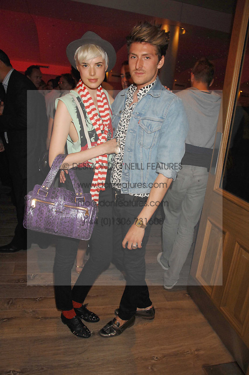 Designer HENRY HOLLAND and model AGYNESS DEYN at a party to celebrate Westfield London's sponsorship of the British Fashion Council's Fashion Forward Awards held at the Haymarket Hotel, 1 Suffolk Place, London on 17th July 2007.<br />