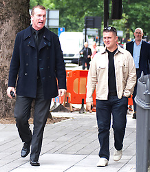 EDL leaders Tommy Robinson and Kevin Carrol appear in court,<br /> English Defence League, leaders ( L   - R ) Kevin Carroll and Tommy Robinson appear at the Westminster Magistrates' Court. Robinson, whose real name is Stephen Yaxley-Lennon, and Carroll are accused of obstructing police by trying to defy a ban on marching to the scene of Fusilier Lee Rigby's murder via the East London Mosque on June 29, 2013, London, United Kingdom. Wednesday, 11th September 2013. Picture by Piero Cruciatti / i-Images