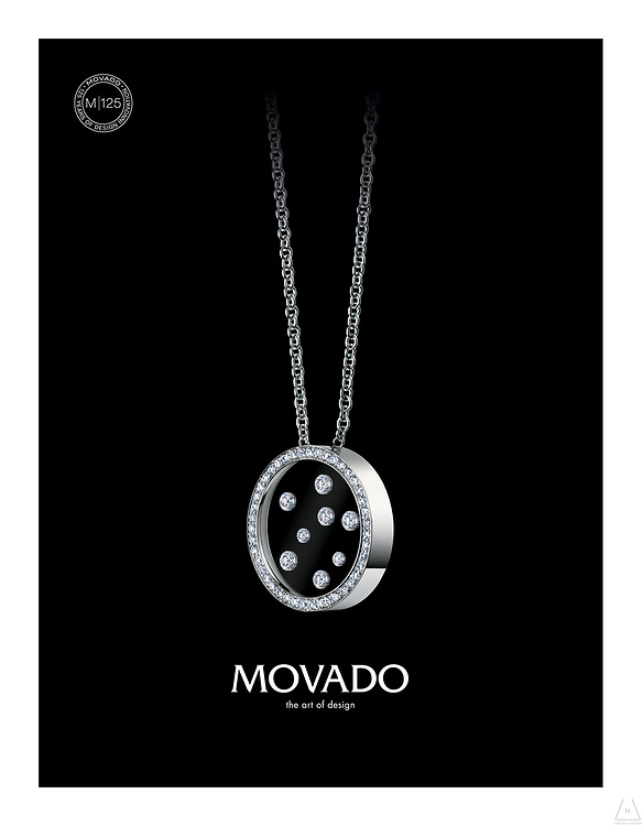 Circular white gold Movado and encrusted diamonds necklace shot in New York by Timothy Hogan