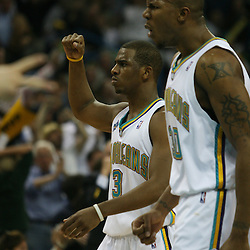 15 April 2008: Chris Paul #3 and David West #30 of the New Orleans Hornets head over to congratulate rookie guard Julian Wright after a slam dunk in the second half of the Hornets 114-92 Southwestern Division clinching victory over the Clippers at the New Orleans Arena in New Orleans, Louisiana.