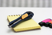 Office Stanley knife, notepad and markers