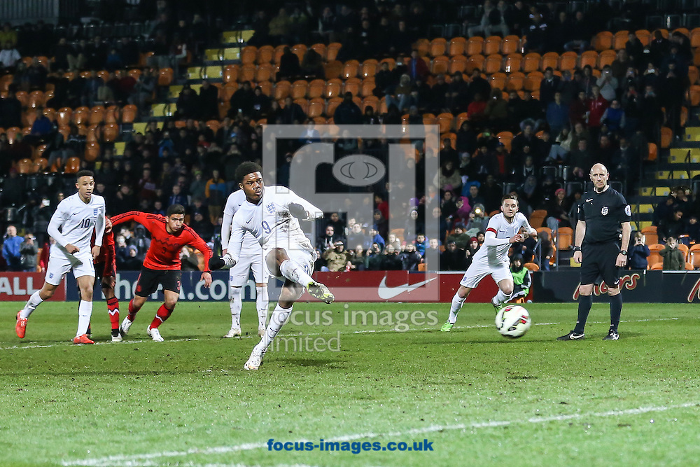 Chuba Akpom scores an equalising goal from the penalty spot to make it 1-1 during the International Friendly match at The Hive Stadium, Harrow<br /> Picture by David Horn/Focus Images Ltd +44 7545 970036<br /> 25/03/2015