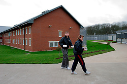 UK ENGLAND NOTTINGHAM 14DEC04 - Prison Guard recruits walk through the living tracts at HMP Lowdham Grange in Nottinghamshire. This newly-built prison is entirely run and controlled by private company Premier-Serco on contract from the Home Office since 1998. The facility holds over 500 Category-B and C inmates with an minimum sentence of 4 years.....jre/Photo by Jiri Rezac....© Jiri Rezac 2004....Contact: +44 (0) 7050 110 417..Mobile:  +44 (0) 7801 337 683..Office:  +44 (0) 20 8968 9635....Email:   jiri@jirirezac.com..Web:     www.jirirezac.com....© All images Jiri Rezac 2004 - All rights reserved.
