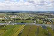 Nederland, Noord-Holland, Gemeente Wormerland, 14-06-2012; Polder Wormer, Jisp en Nek met de lintbebouwing van het dorp Jisp. De verkaveling in het gebied is het resultaat van veenontginning. Aan de horizon Zaandam (Zaanstad)..Polder in province North Holland (above Amsterdam) with villages. The division in plots in the area is the result of peat extraction..luchtfoto (toeslag), aerial photo (additional fee required);.copyright foto/photo Siebe Swart