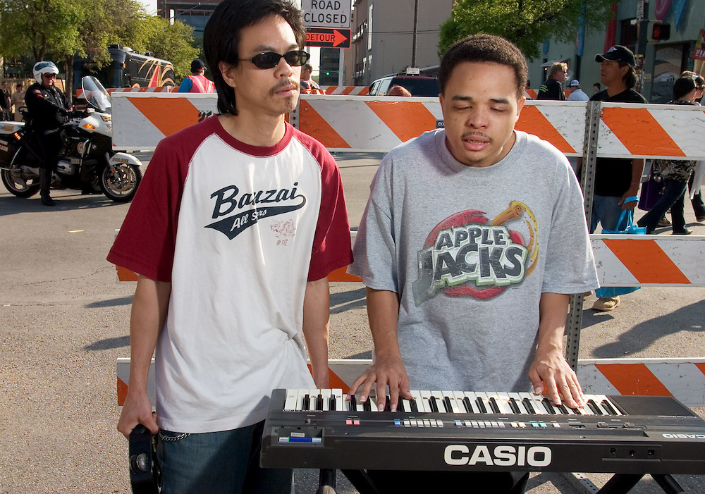 The dynamic duo of Foot Patrol, performing at the intersection of Red River Dr. and Sixth St. during the SXSW Music Festival in Austin, TX. All of their original songs deal with foot fetishes.