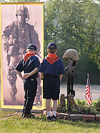 Town of Wallkill, N.Y. - Two Cub Scouts look at a soldier's boots, weapons and helmet, which  were among the items on display during a Memorial Day service at the Town of Wallkill Veterans Park on May 29, 2006. ©Tom Bushey