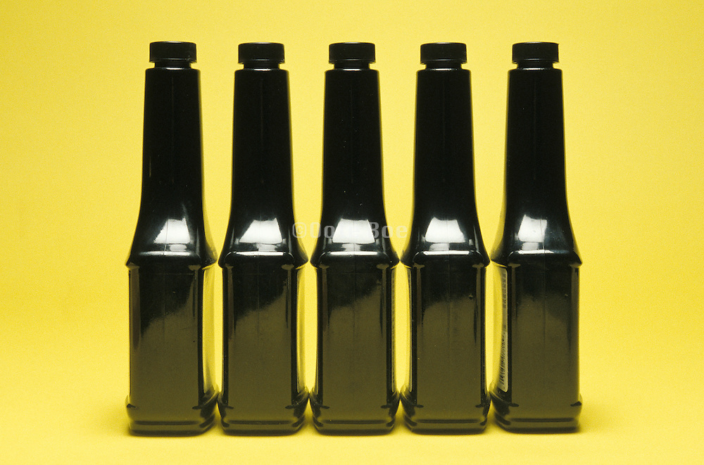 row of black bottles