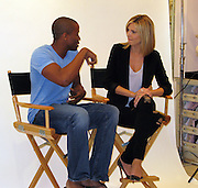 """Heidi Klum and Black Male Model..German Model Heidi Klum promoting the """"perfect bra""""..Victoria's Secret Store..The Grove..West Hollywood, CA.German Model Heidi Klum was promoting the """"perfect bra"""" at The Grove's Victoria's Secret in West Hollywood, CA, but since she was all covered up and not showing her body or the bra, most people didn't showed up..The hired security and a sales person, were in front of the store trying to get people to go inside by telling them, """"You can get a photo with Heidi Klum for free"""", but once inside people were disappointed when they saw Heidi was not wearing the bra..A hunk black male model waited on line to take a photo with Heidi, when his time came he asked Heidi if he could take his shirt off, she said of course, and they posed for the photo..A disappointed Heidi over the turnout avoided the awaiting paparazzi outside by sneaking throughout the back of the store with heavy security..Tuesday, March 03, 2009..Photo By Celebrityvibe.com.Website: www.celebrityvibe.com;.To license this image please call (212) 410 5354 or email: Celebrityvibe@gmail.com"""