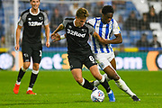 Kieran Dowell of Derby County (8) and Terence Kongolo of Huddersfield Town (5) in action during the EFL Sky Bet Championship match between Huddersfield Town and Derby County at the John Smiths Stadium, Huddersfield, England on 5 August 2019.