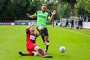 Hampton & Richmond defender Jack Strange tackles AFC Wimbledon midfielder Scott Wagstaff (7) during the Pre-Season Friendly match between Hampton & Richmond and AFC Wimbledon at Beveree Stadium, Richmond Upon Thames, United Kingdom on 27 July 2019.
