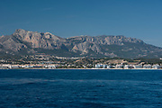 Altea coast with Puig Campana and Ponoch mountains from mediterranean sea, Alicante province, Spain, Europe