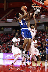 22 December 2015: Marcus Roper(2) shoots over defender Nick Banyard(0). Illinois State Redbirds host the Tennessee State Tigers at Redbird Arena in Normal Illinois (Photo by Alan Look)