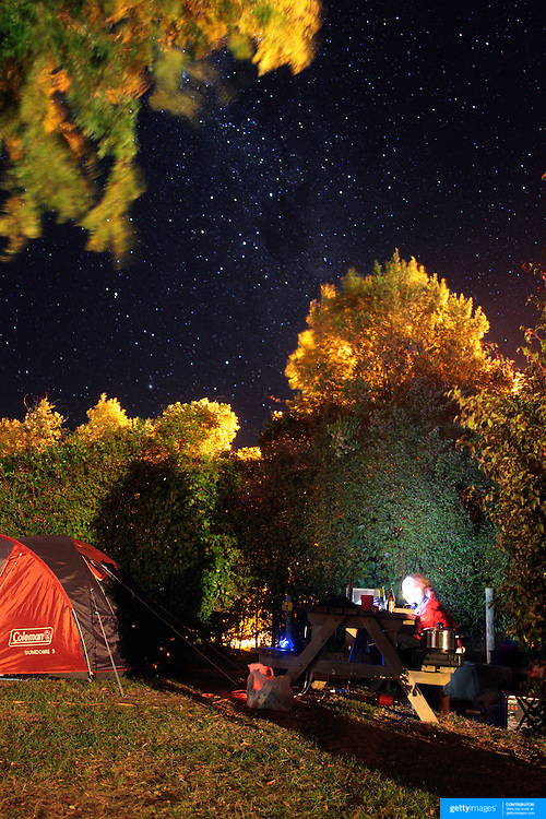 Tourists camping under the stars on a remote camp site near Nelson, South Island, New Zealand Photo Tim Clayton