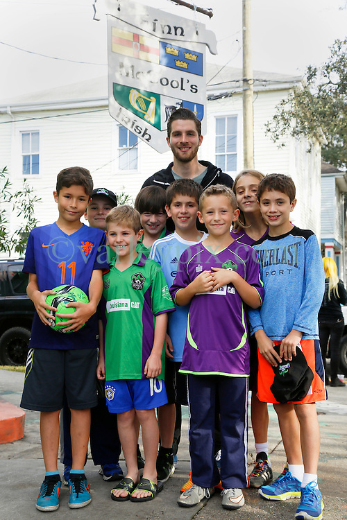 23 November 2015. Finn McCool's Irish Pub, New Orleans, Louisiana.<br /> Major League Soccer (MLS) star player Patrick Mullins of New York City FC poses for a photo with young soccer players from the New Orleans Jesters Junior Academy.<br /> Photo©; Charlie Varley/varleypix.com