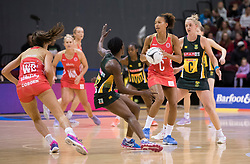 England's Serena Guthrie, centre, looks to pass the ball against South Africa in the Netball Quad Series netball match, ILT Stadium Southland, Invercargill, New Zealand, Sept. 3 2017.  Credit:SNPA / Adam Binns ** NO ARCHIVING**
