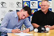 Kyle Glogoski signs for the Philadelphia Phillies with Philadelphia Phillies scout Howard Norsetter.<br /> Kyle Glogoski at the Philadelphia Phillies signing ceremony held at Lloyd Elsmore Park, Pakuranga, Auckland, New Zealand. 4 January 2018. &copy; Copyright Image: Marc Shannon / www.photosport.nz.