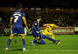 Ollie Clarke of Bristol Rovers is tackled - Mandatory byline: Robbie Stephenson/JMP - 07966 386802 - 26/12/2015 - FOOTBALL - Kingsmeadow Stadium - Wimbledon, England - AFC Wimbledon v Bristol Rovers - Sky Bet League Two