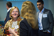 Ekaterina Rekhovskaya of Flagship talks with other guests during the Silicon Valley Business Journal's HHaaS Tech Mixer at ZERO1 in San Jose, California, on May 28, 2015. (Stan Olszewski/SOSKIphoto for the Silicon Valley Business Journal)