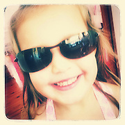 Young girl in adult sunglasses