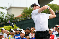 October 13, 2018 - Kuala Lumpur, Malaysia - Bronson Burgoon of the United States plays his shot on the 1st green during round three of the CIMB Classic at TPC Kuala Lumpur on 13 October, 2018 in Kuala Lumpur, Malaysia  (Credit Image: © Chris Jung/NurPhoto via ZUMA Press)