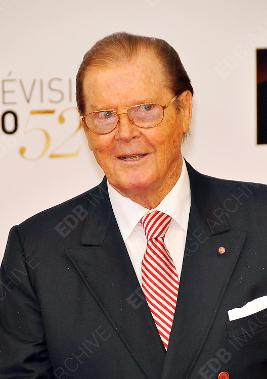 10.JUNE.2012. MONACO<br /> <br /> ROGER MOORE AND WIFE KRISTINA THOLSTRUP ATTEND THE OPENING CEREMONY OF THE 52ND MONTE CARLO TELEVISION FESTIVAL HELD AT THE GRAMALDI FORUM.  <br /> <br /> BYLINE: EDBIMAGEARCHIVE.CO.UK<br /> <br /> *THIS IMAGE IS STRICTLY FOR UK NEWSPAPERS AND MAGAZINES ONLY*<br /> *FOR WORLD WIDE SALES AND WEB USE PLEASE CONTACT EDBIMAGEARCHIVE - 0208 954 5968*