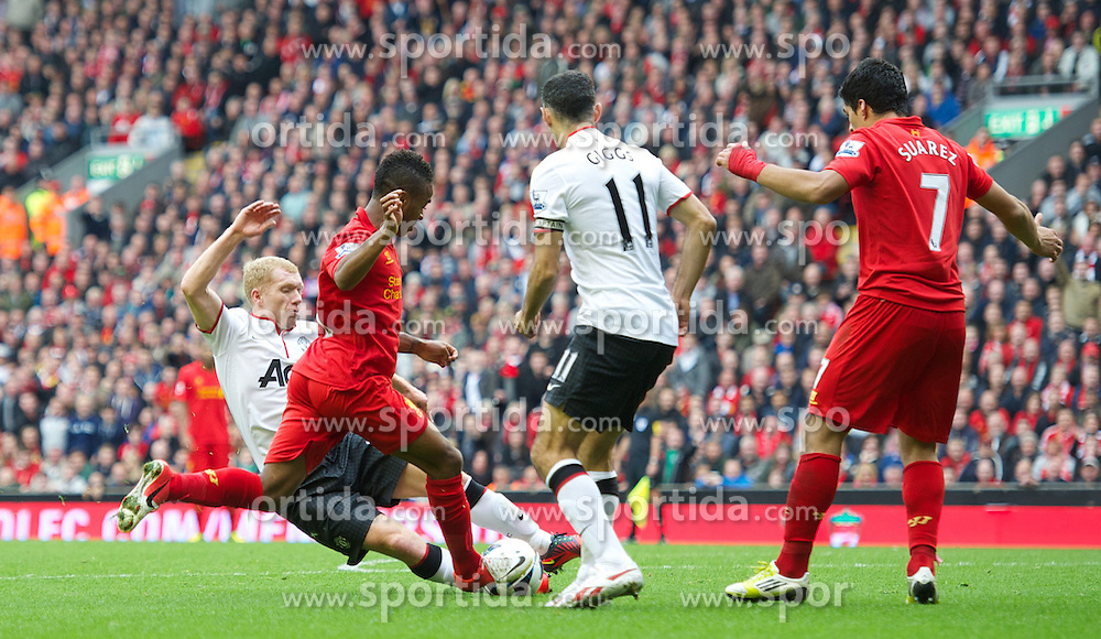 23.09.2012, Anfield, Liverpool, ENG, Premier League, FC Liverpool vs Manchester United, 5. Runde, im Bild Liverpool's Raheem Sterling is hacked down by Manchester United's Paul Scholes but no penalty was awarded during the English Premier League 5th round match between Liverpool FC and Manchester United at Anfield, Liverpool, Great Britain on 2012/09/23. EXPA Pictures © 2012, PhotoCredit: EXPA/ Propagandaphoto/ David Rawcliff..***** ATTENTION - OUT OF ENG, GBR, UK *****