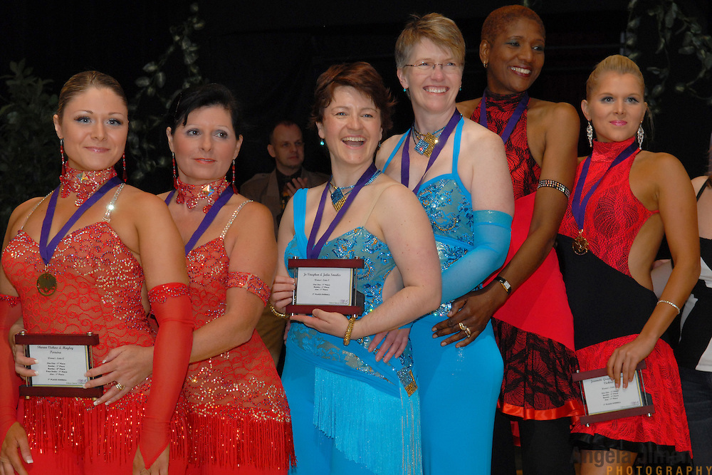 Same-sex women's latin ballroom dancers Hayley Perreira, from left, with Sharon Vickers, of Reading, England, Jo Vaughan with Julia Smailes of London, England, and Jeannette Green with Lorraine Vickers, of Reading, England, pose for a photo with their awards at the 5 Boro Dance Challenge on May 5, 2007...The locally produced 5 Boro Dance Challenge, New York City's first major same-sex dance competition, was held at the Park Central Hotel in Manhattan from May 4-6, 2007. .